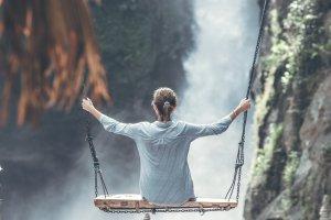 Girl Swinging By Waterfall
