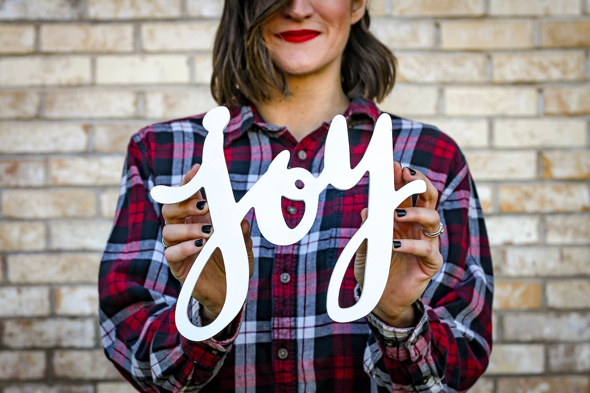 Woman in Plaid with Word Joy