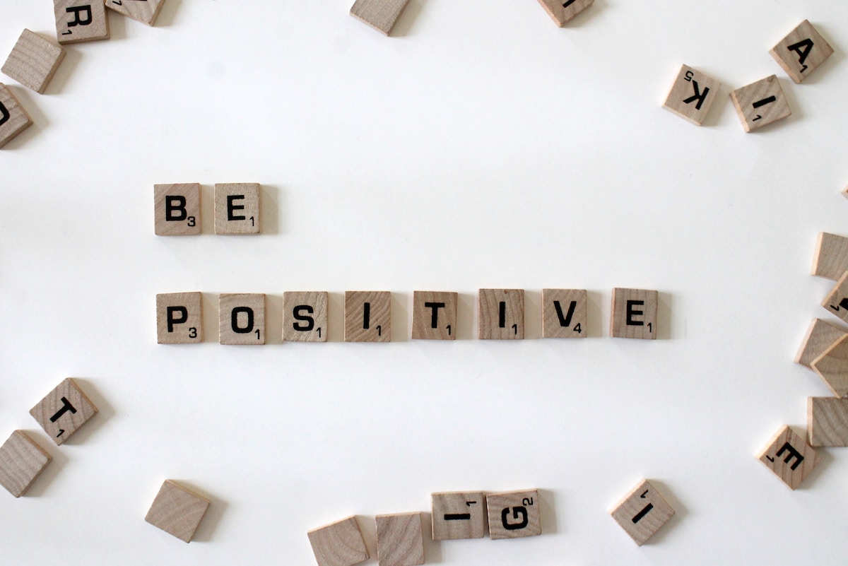 Positivite Spelled with Scrabble Pieces